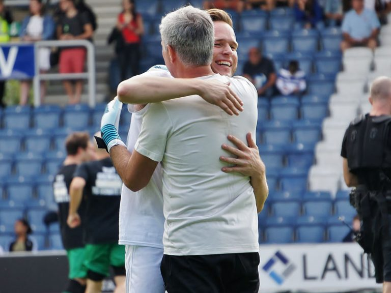 Game for Grenfell Olly Murrs hugging Jose Mourinho